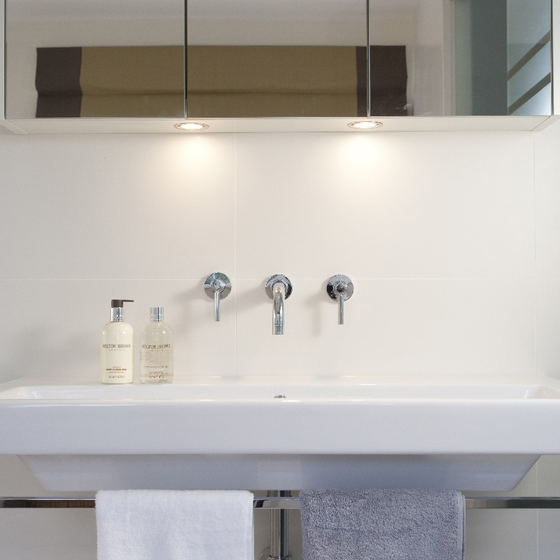 Luxury Bespoke Bathroom. White Limestone. White Sink.