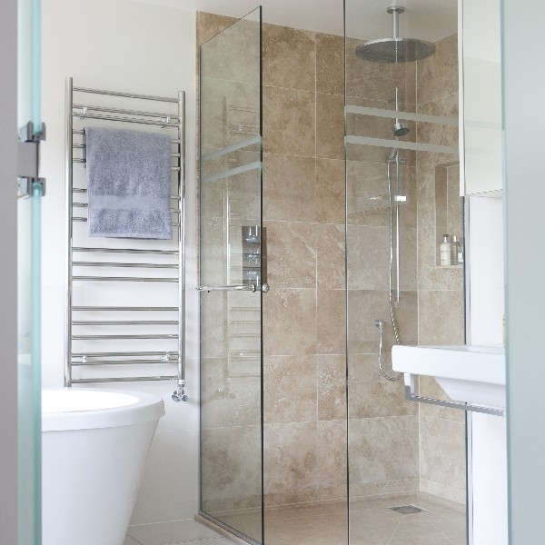 Luxury Bathroom. Bespoke Limestone Shower. Glass Door. Light and Bright.