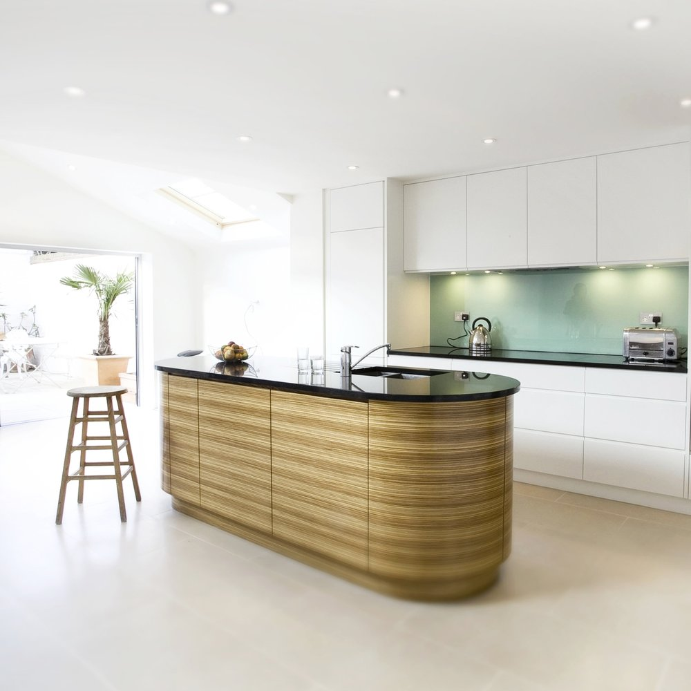 Modern Bespoke Kitchen. Open Plan. White Lacquer Cupboard. Bespoke Furniture. Zebrano Wooden Island. Light Green Glass Splash Back. Open Plan Black Worktops. Black Worktops.