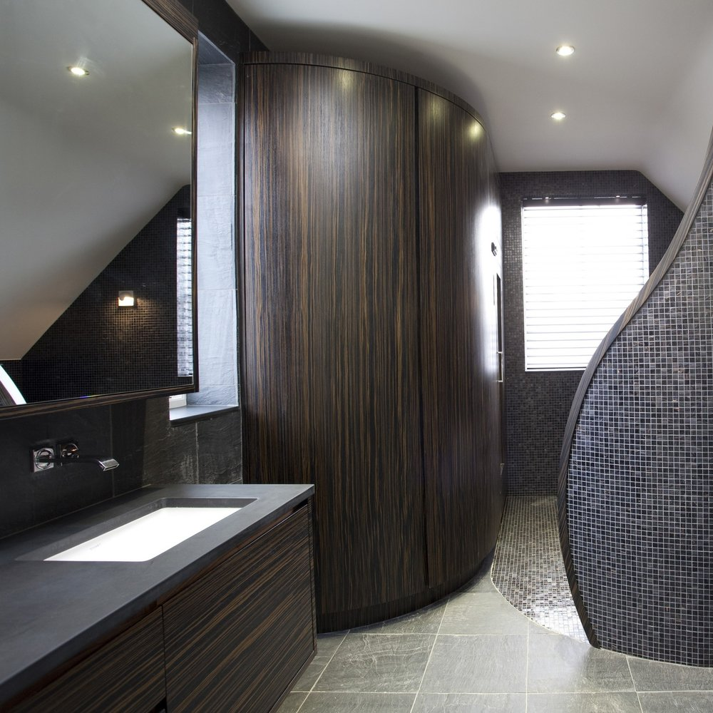 Luxury Bespoke Bathroom. Double Slate Basin. Sauna Room. Macassar Wood Furniture. Bespoke Furniture. Slate Floor. Slate Wall. Mosaic Wall.