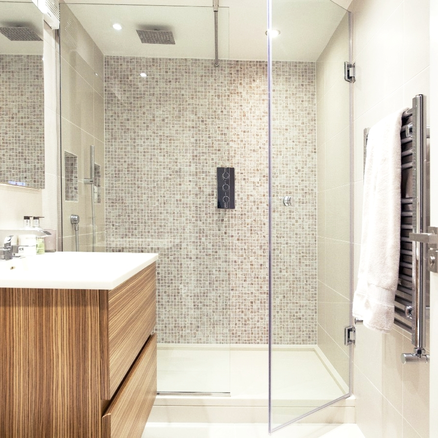 Bespoke Guest Bathroom. Light Tiles. Bespoke Wood Cupboard. Large Glass Shower. Bespoke Shower. Mosaic Wall.