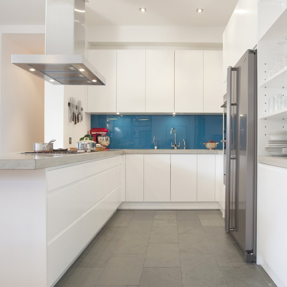 Bespoke Modern/Minimalist Kitchen Design. White Lacquer. Grey Concrete Worktops. Open Kitchen. Blue/Turquoise. Stale Floor.