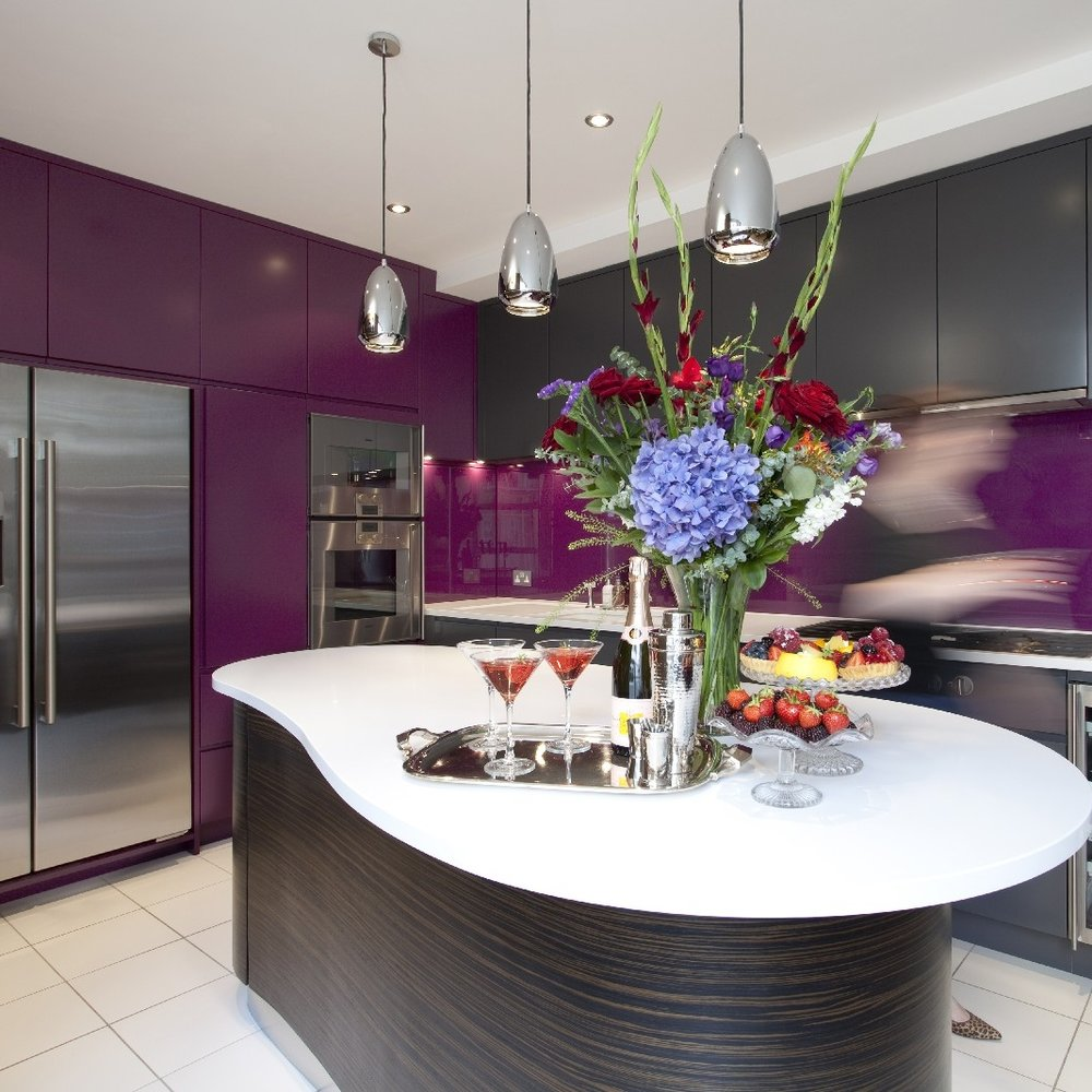 Modern Bespoke Kitchen. Macassar Ebony- Veneer Wooden Island Cooking. Purple and Grey Lacquer. Purple Glass Splash Back. Brick Walls. White Tiles.