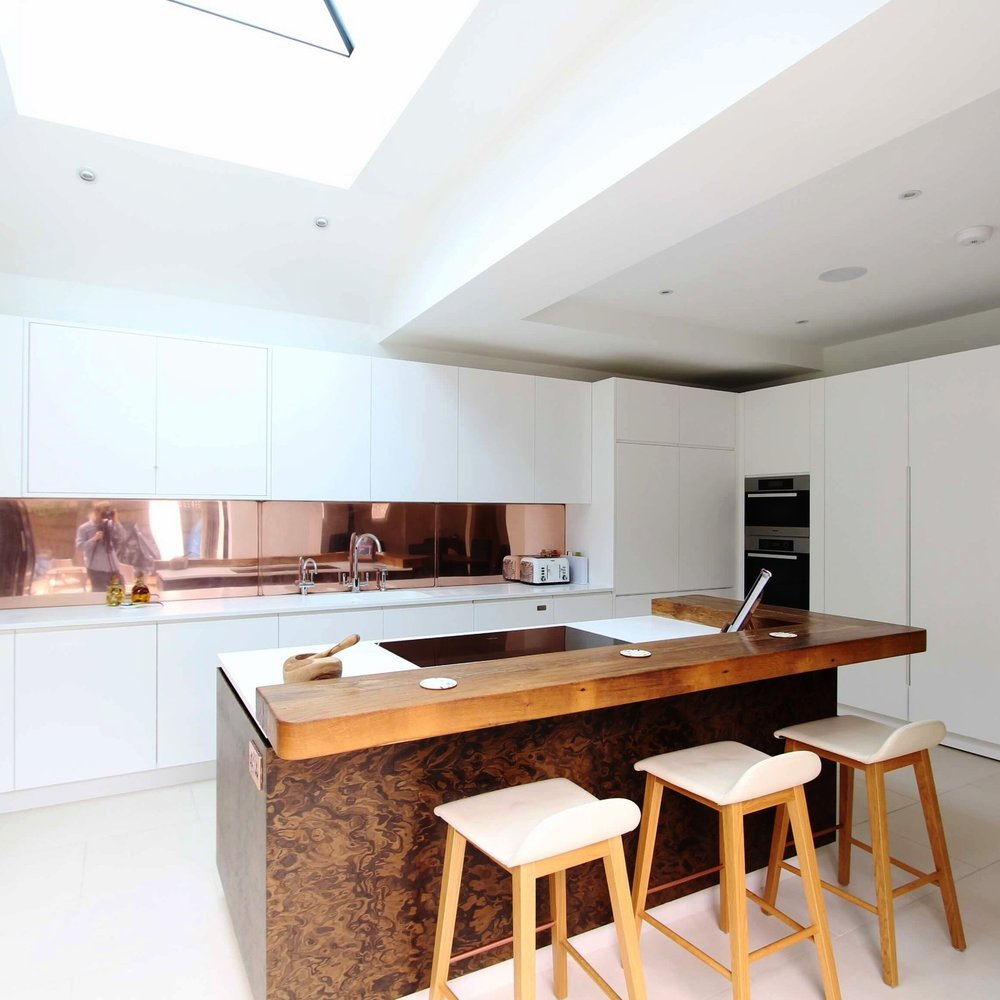 Luxury Bright Bespoke Kitchen. White Lacquer. Copper Splash Back. Oak Breakfast Island.