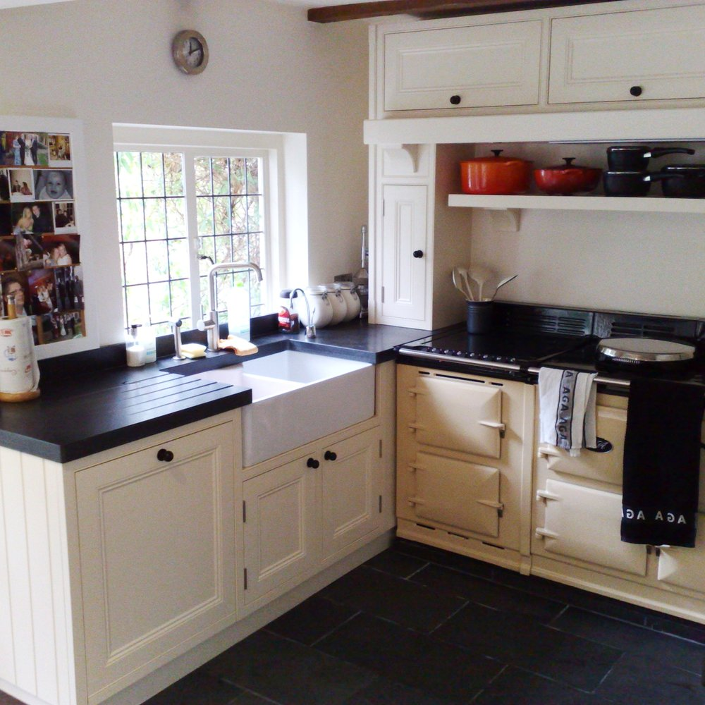 Traditional Bespoke Kitchen. Handmade Furniture. Country Style. Wooden Cabinetry. Black Slate Floor. Traditional Style Aga Cooker In Gas