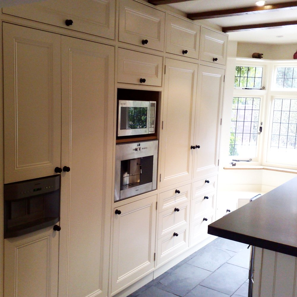 Traditional Bespoke Kitchen. Handmade Furniture. Country Style. Wooden Cabinetry. Black Slate Floor.