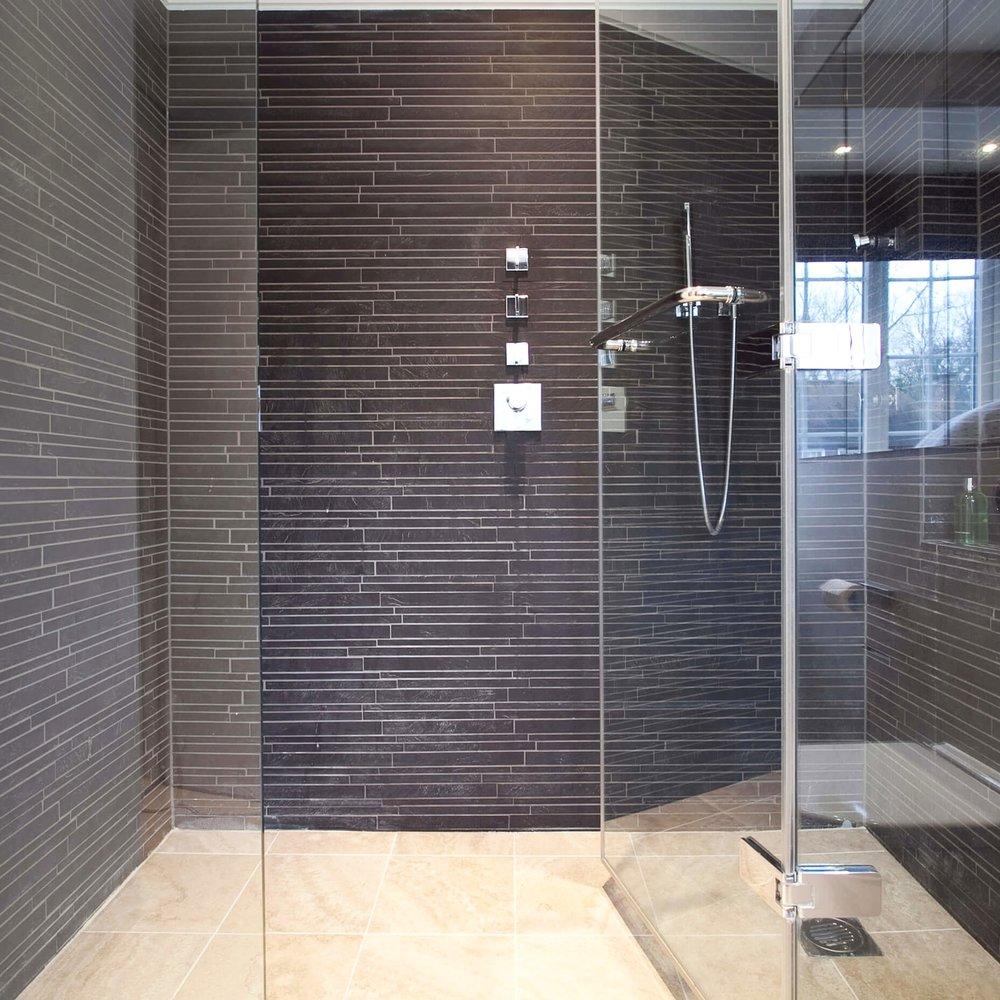 Bespoke Design Bathroom. Large Italian Shower. Black Fine Slate.