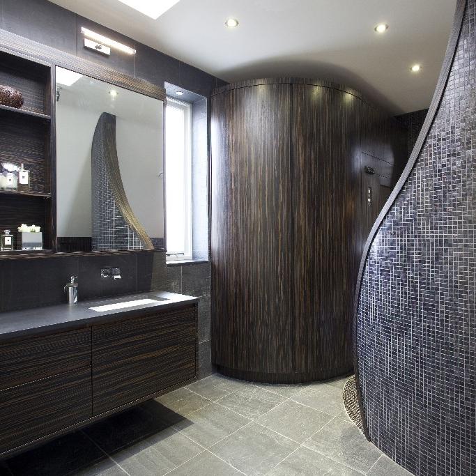 Luxury Bathroom. Cocooning Freestanding Bath. Black Mosaic Tiles.