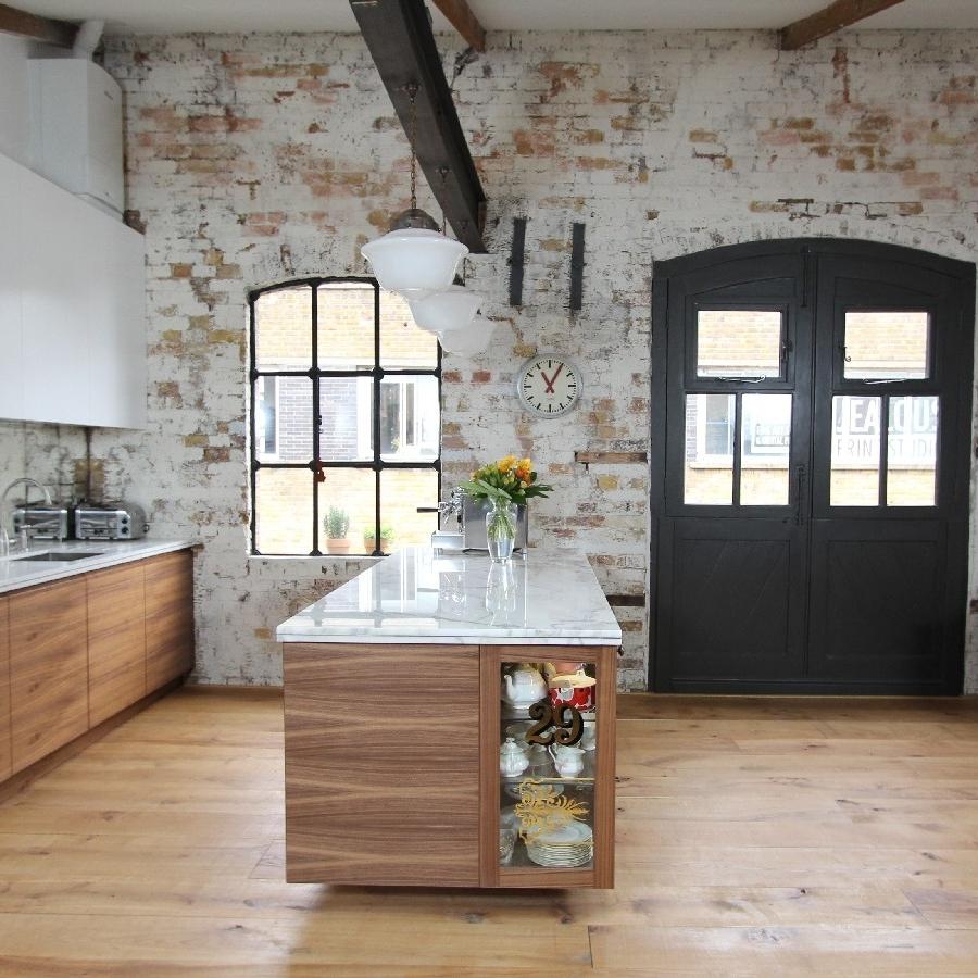 Modern/Vintage Bespoke Kitchen. Bespoke Furniture. White Lacquer. Walnut Wood. Marble Worktops. Brass Inlay. Mirror Splash Back. Brick Walls.