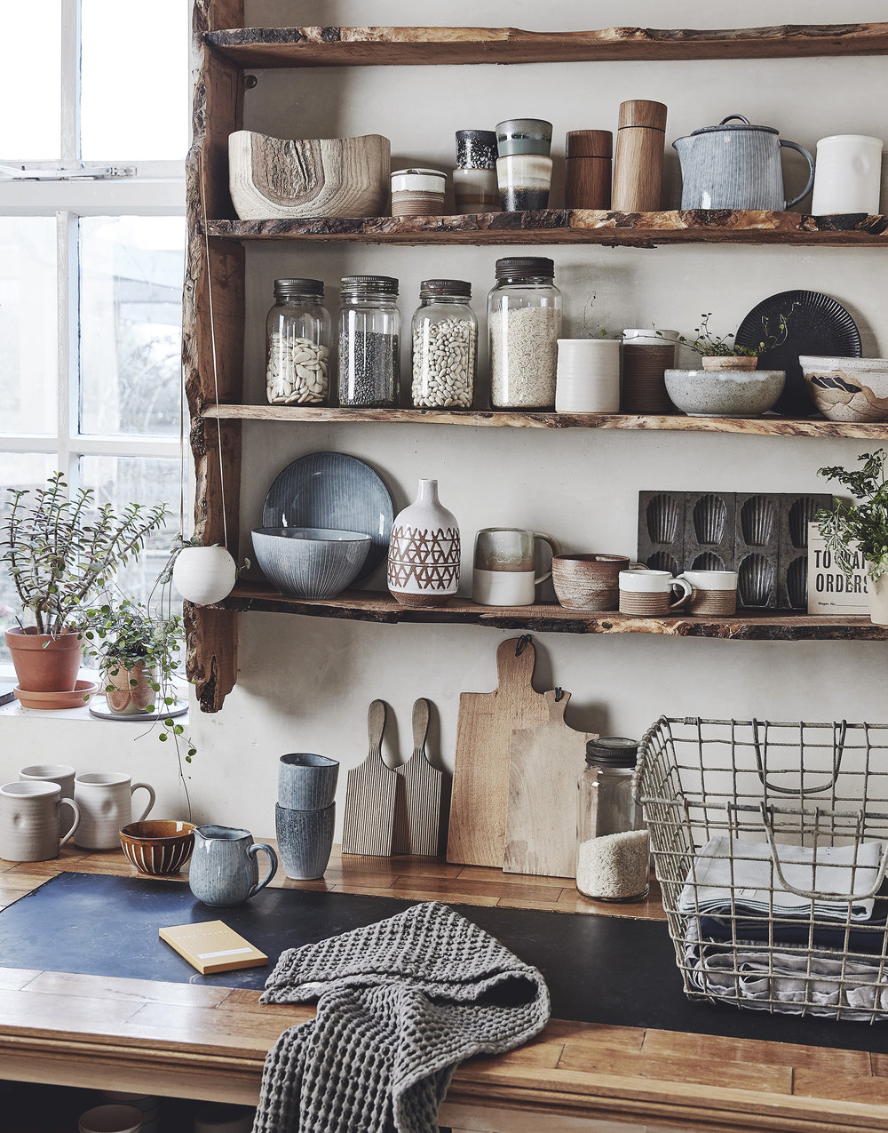 TOP SHELF: Items available from    Folk Interiors   ; 2nd SHELF: Vintage kilner jars –    The Old Potato Store   ; Snow tall beaker –    Room 356   ; Rebecca Morris Bowls –    Object Style   ; BOTTOM SHELF: Broste Copenhagen pottery -    Folk Interiors   ; Rebecca Morris Pottery and espresso cups –    Object Style   ; Vintage Madelaine tin & old signage –    The Old Potato Store   ; WORKTOP: Vintage oyster basket, chopping boards and butter pats -    The Old Potato Store   ; Blue Broste Copenhagen jug and beakers –    Folk Interiors   ; Waffle Tea towel –    Such and Such   ; Dimple ceramic mugs –    Room 356