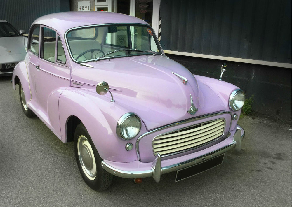 Little purple car outside garage.jpg