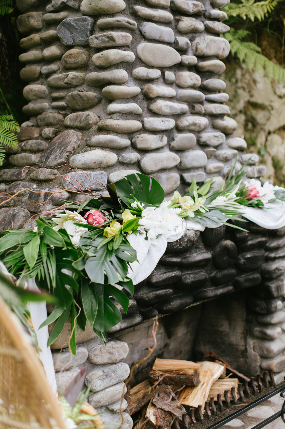 Tropical Wedding Fireplace Protea Orchids Garland Wedding Monstera Photoshoot