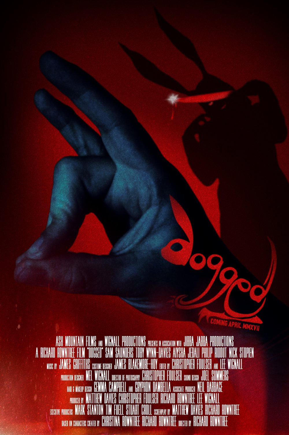 """Dogged"" is a dark psychological thriller in the folk-horror sub-genre and was financed entirely through the crowdfunding platform Kickstarter.""When Sam returns home to the small tidal island where he grew up, he soon discovers that the rural community there harbour more than just a few secrets. As he tries to uncover the truth behind a young girl's mysterious death, he's lured into a dangerous cat-and-mouse game with a sinister group of masked maniacs who will stop at nothing to protect their identities, and hide the horrifying truth about the island."""