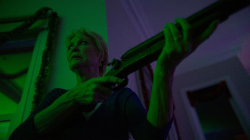 Philadelphia, PA - Artsploitation has released the first images for their upcoming release of the Australian horror film  Red Christmas .  Genre icon Dee Wallace ( The Hills Have Eyes, The Howling, E.T., Cujo, Critters ) stars as the stressed-out mother of a squabbling family, gathered together in a remote Outback estate on Christmas Eve.  Their petty dramas threaten to blacken the holiday until a mysterious and deformed stranger appears at the door seeking bloody vengeance.