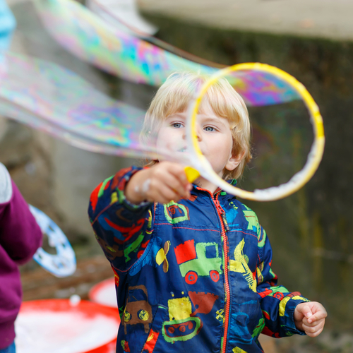 Boy playing with soap bubble