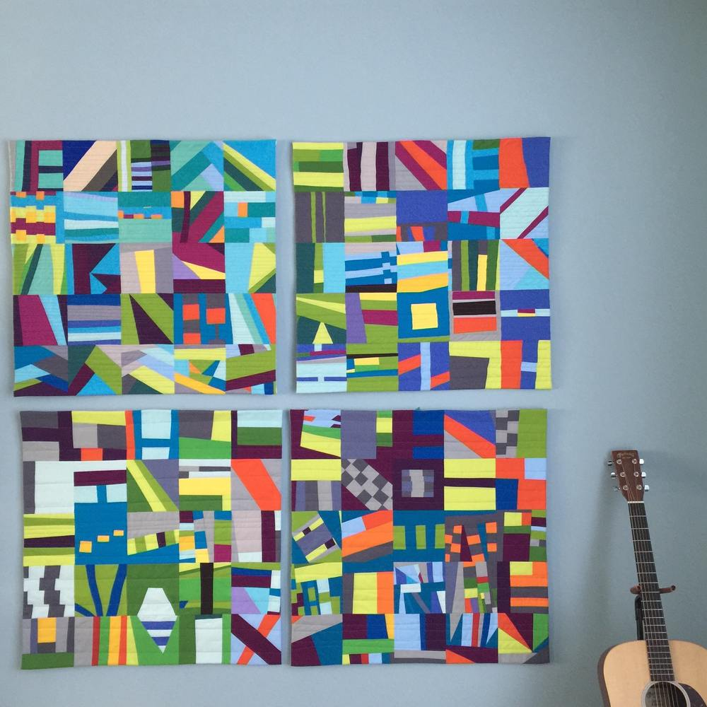 All 4 quilts in my 100 Day series, 2015. The guitar is there for scale.