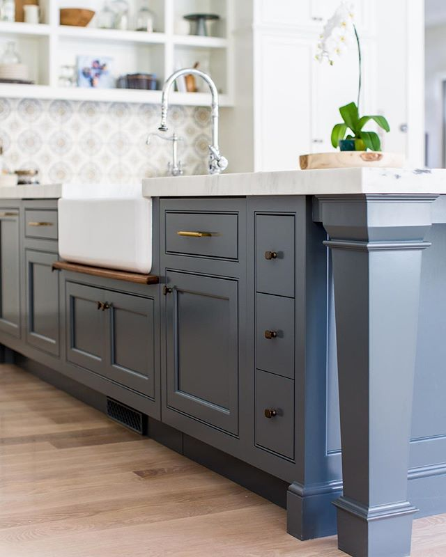 Something that has been funny to me is how I've gotten so many requests for specifics on the design of this type of leg. We worked with @caitlincreerinteriors to design a similar leg on @emilyijackson 's kitchen a couple years ago. I've even had other local cabinet shops pay me to replicate them! Needless to say, it's been an unexpected obsession.... one more thing, I love hiding dishwashers. They aren't a traditional appliance. This island has two dishwashers, but you wouldn't know it.  Color is: F&B Downpipe. 📷 @lindsay_salazar_photography