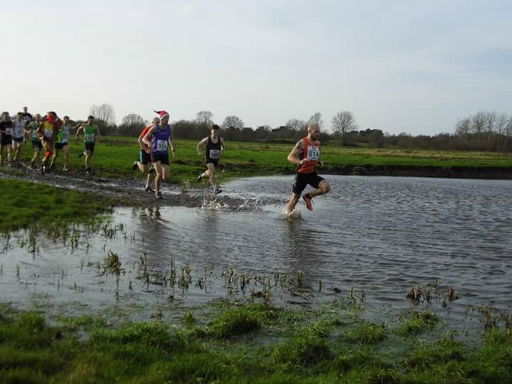 "Me in 4th place (in the red shirt) entering the ""pond"" next to James who won (in the blue vest)"