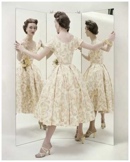model-standing-in-front-of-three-way-mirror-wearing-a-pale-yellow-summer-party-dress-by-kane-with-matching-mules-by-valley-photo-richard-rutledge-april-1954-22three-views-of-a-summer.jpg