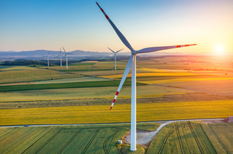 huge-wind-turbine-in-a-field-at-sunset-showing-energy-infrastructure.jpg