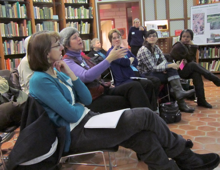 A participant asks a question in a discussion at the Morton Arboretum about urban wetland restoration, which included the Spring Brook project.