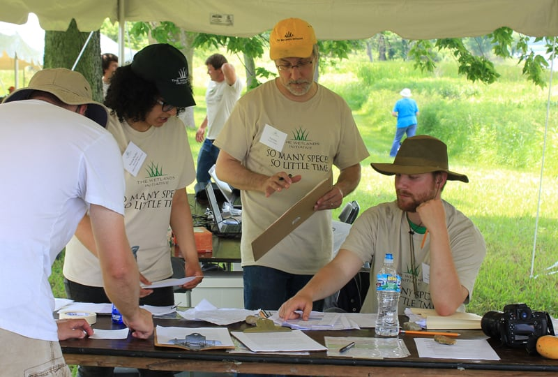Members of TWI's seasonal field crew, including Nav Pandher (left) and Trevor Phillips (right), did a great job checking in participants and keeping base camp running smoothly. TWI Executive Director Paul Botts (center) was in charge of coordinating transportation! Photo by Beth Botts.