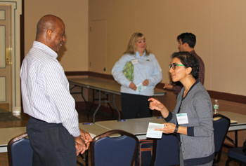TWI project partner Mahsa Izadmehr (right) talks with a session attendee at the Illinois Water Conference on October 27 after her presentation on water quality monitoring of TWI's first farm-based wetland.