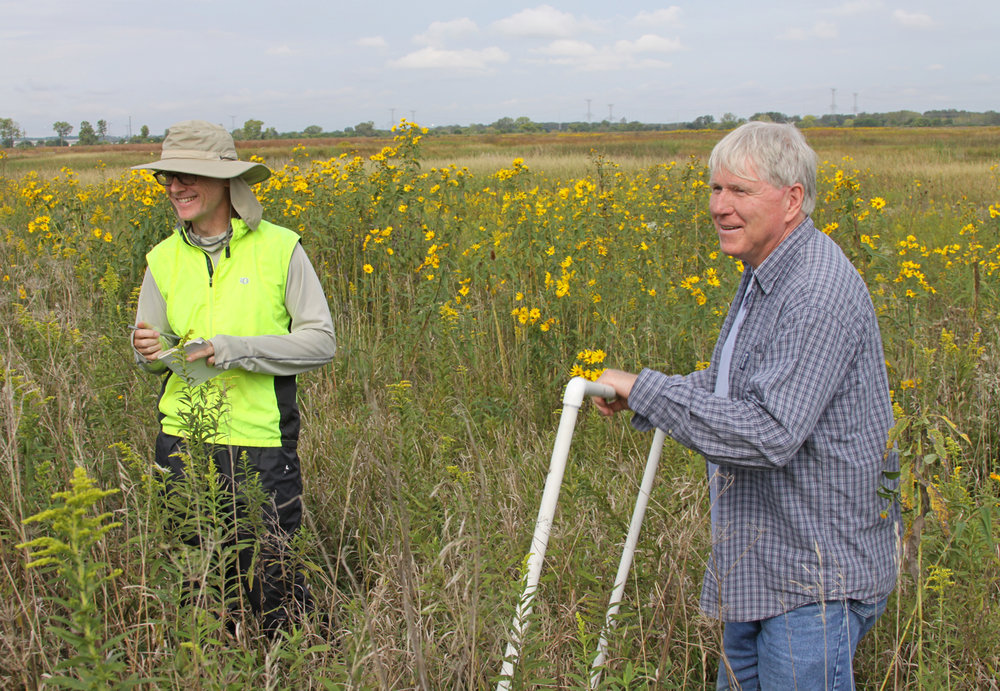 TWI Senior GIS Analyst Jim Monchak (left) and Senior Ecologist Dr. Gary Sullivan (right) collecting post-restoration monitoring data with a meter-square guide at Lobelia Meadows in summer 2016. Photo by Vera Leopold/TWI.