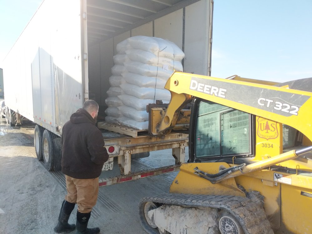TWI Midewin Project Manager Trevor Edmonson watches as bags of native seed are unloaded off a truck. In all, TWI planted 9,817 pounds of seed across 574 acres. Photo by Donald Gross/TWI.