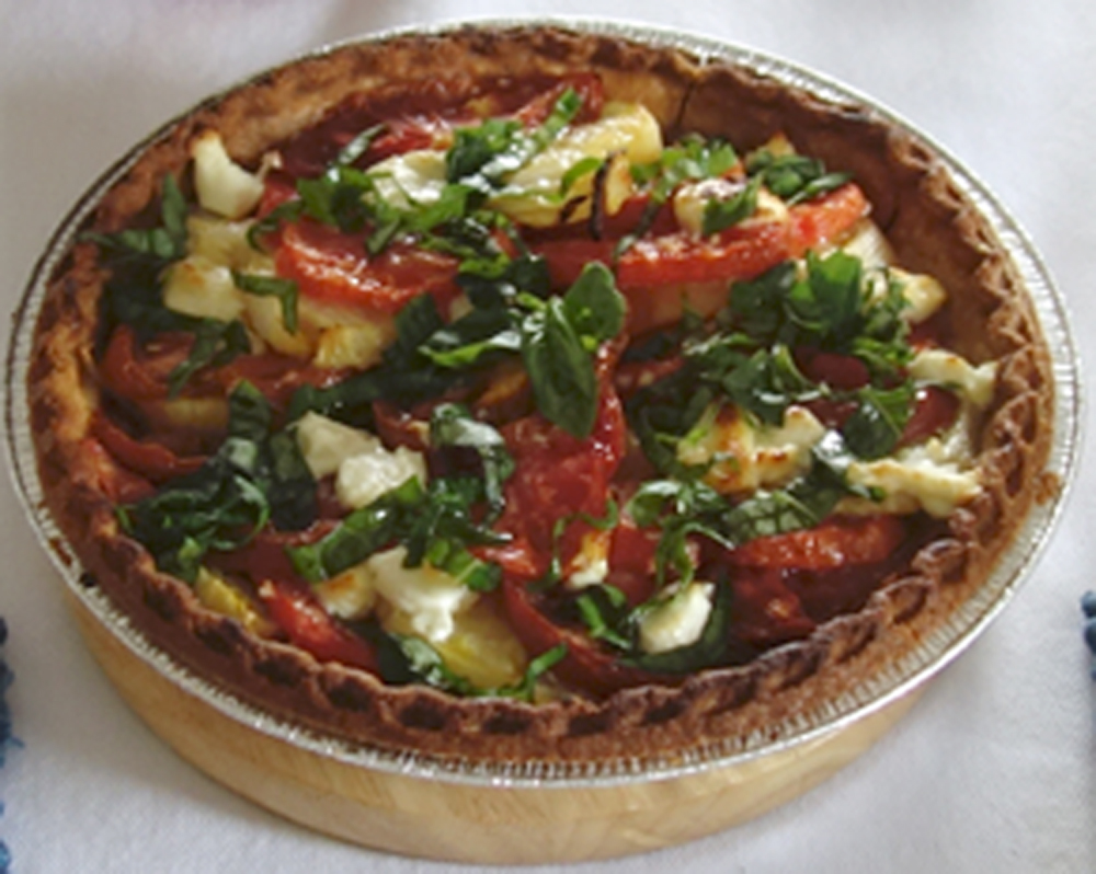 Warm and savory. The sweetness of the tomatoes balances the tang of the goat cheese.