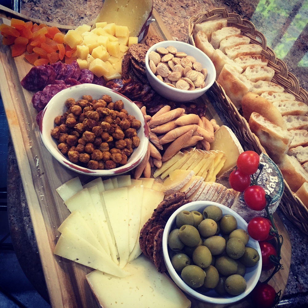Abundant charcuterie platter with cheeses, dry cured meats, Marcona almonds, dried apricots and of course, Spicy Chick Peas.
