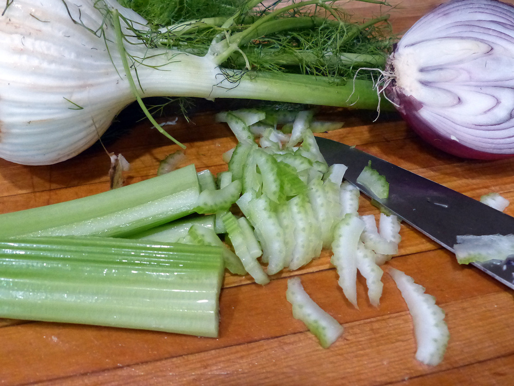 Slices of celery, thin enough to mingle but thick enough to provide crunch.