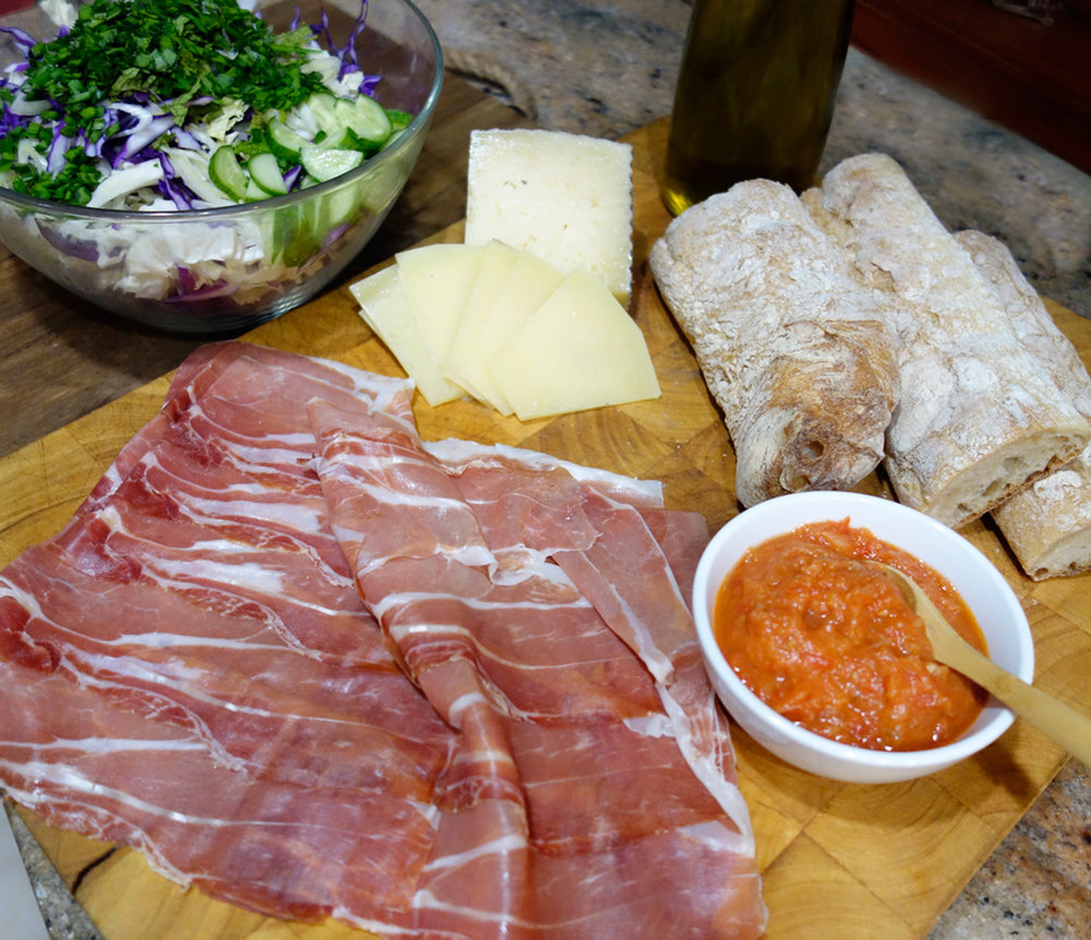 "The ""spread"": Serrano ham, Manchego cheese, baguette and of course, tomato fennel spread"