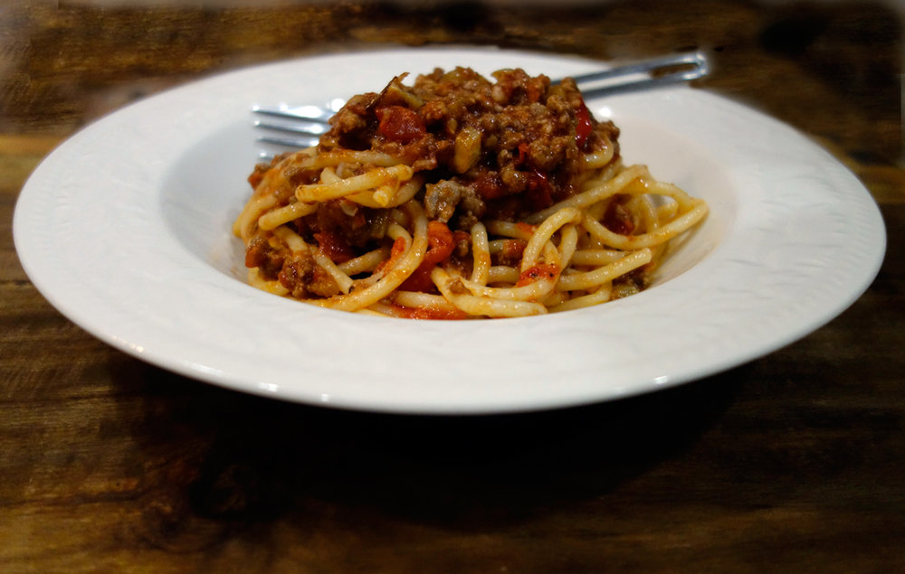 Thick spaghetti with rich, hearty meat ragu.