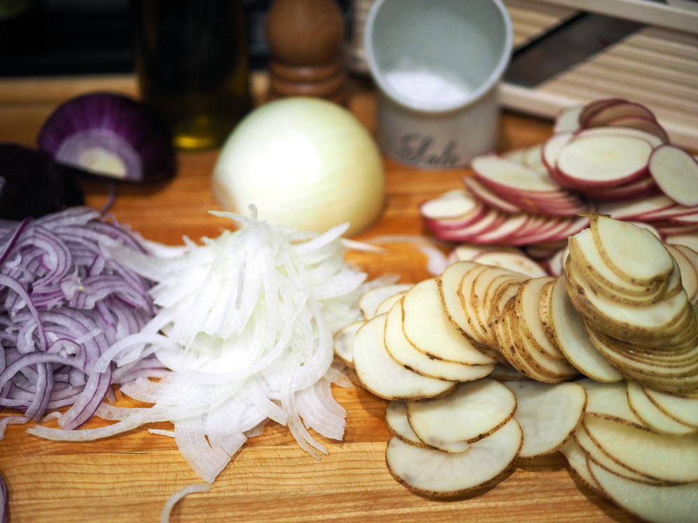 Slices of potatoes and onions