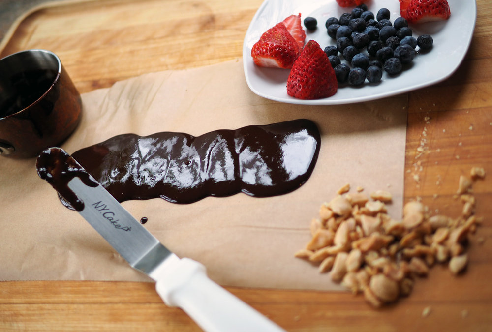 Spread the chocolate onto parchment paper.