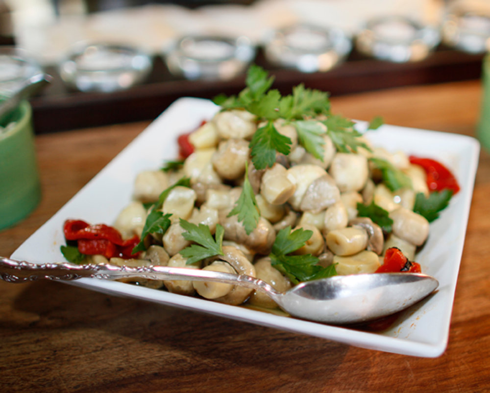 Marinated mushrooms, store bought and then enhanced with fresh parsley and roasted peppers