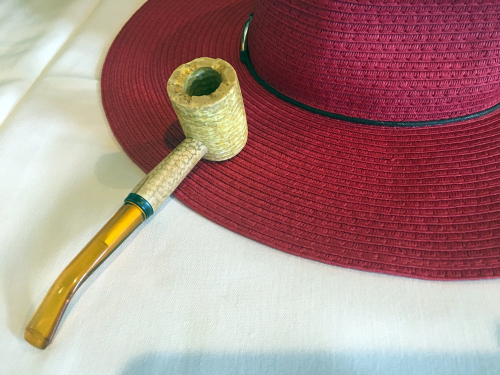 Aunt Catherine's favorite hat and her corn cob pipe.  No button nose here.