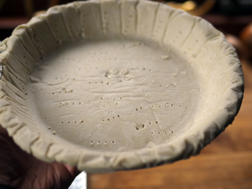 Prep the crust by making fork holes to prevent from bubbling up.