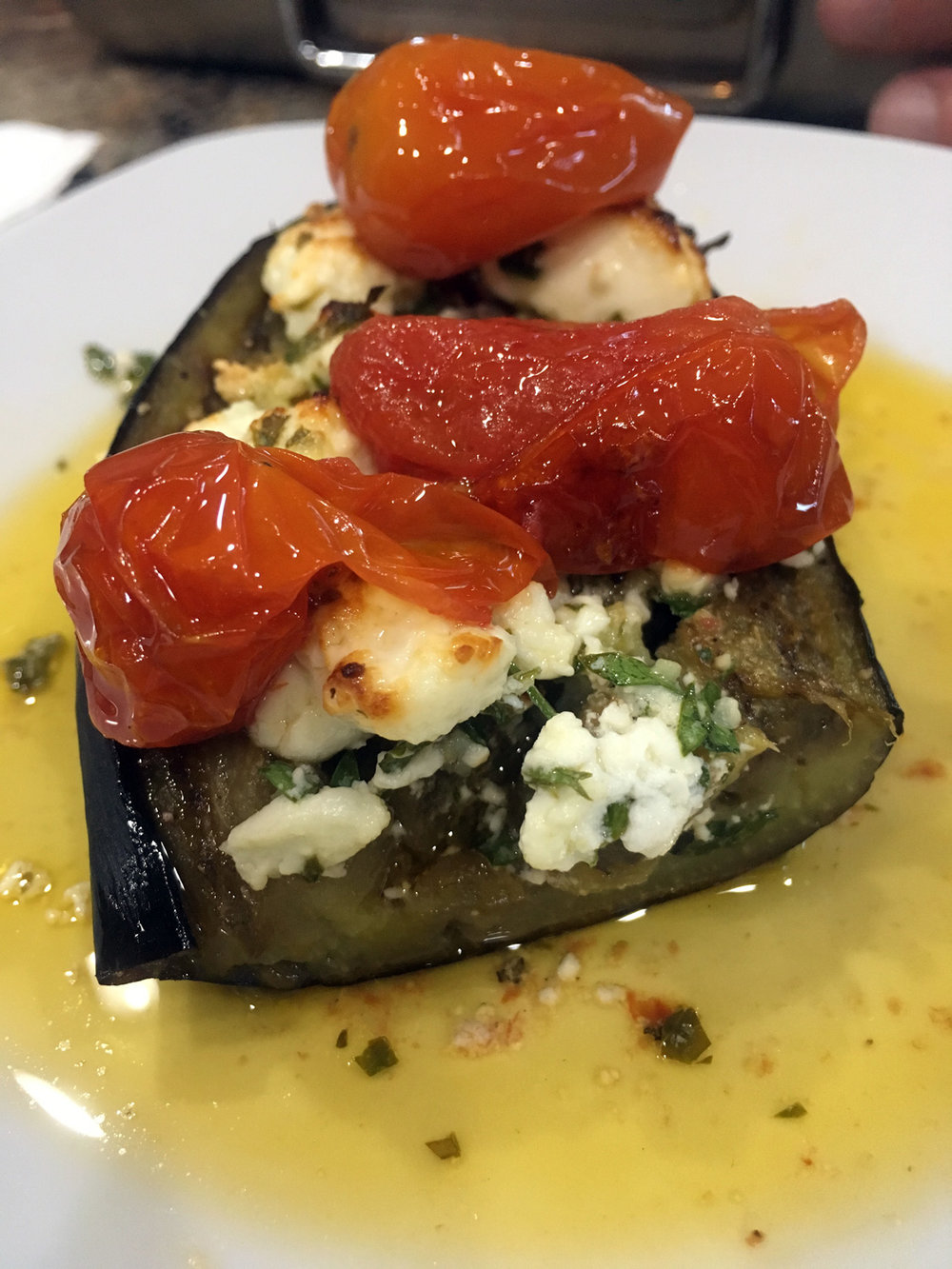 Roasted eggplant with  feta gremolata  and  roasted tomatoes .  Honestly, having a ton of roasted tomatoes in your fridge or freezer is your best secret weapon.  The dishes you can make are endless!