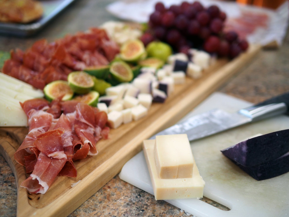 It's always good to have a full board of charcuterie and cheese mixed with fruits, olives and nuts.