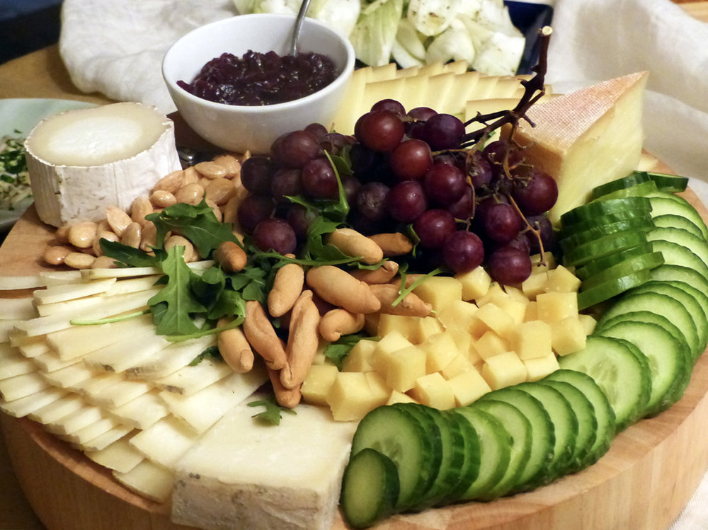 Cheese board filled with sweet and savory.