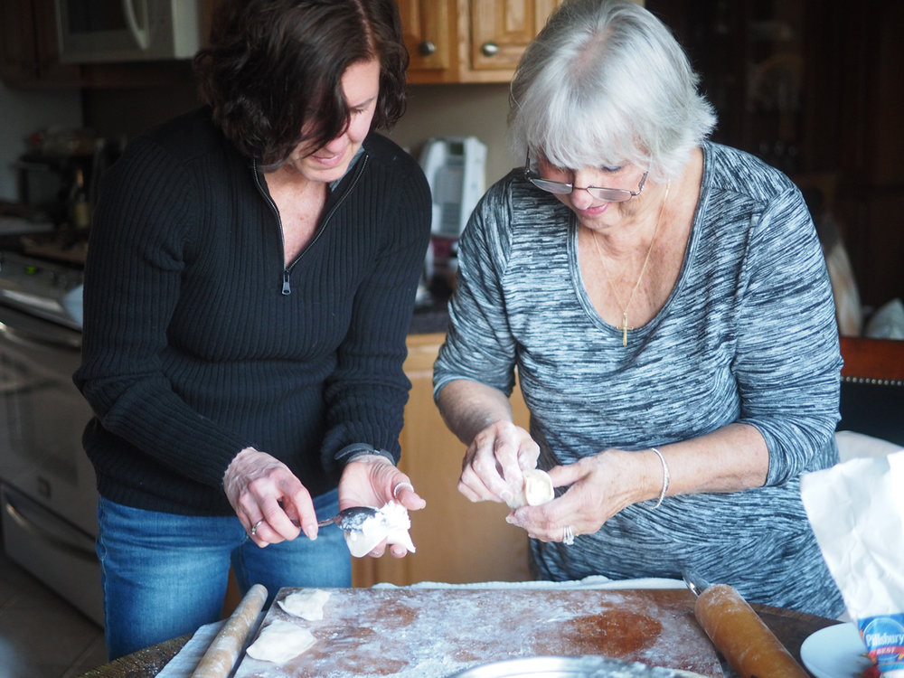 Alyssa and Mom happily making, and anticipating the finished product. Is there anything more heartwarming than keeping traditions alive with your mom? I don't think so.