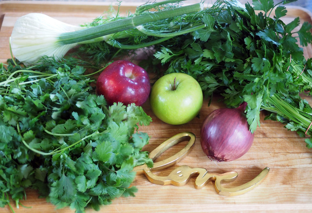 Nothing but cilantro, fennel, red and green apples, parsley and red onion.