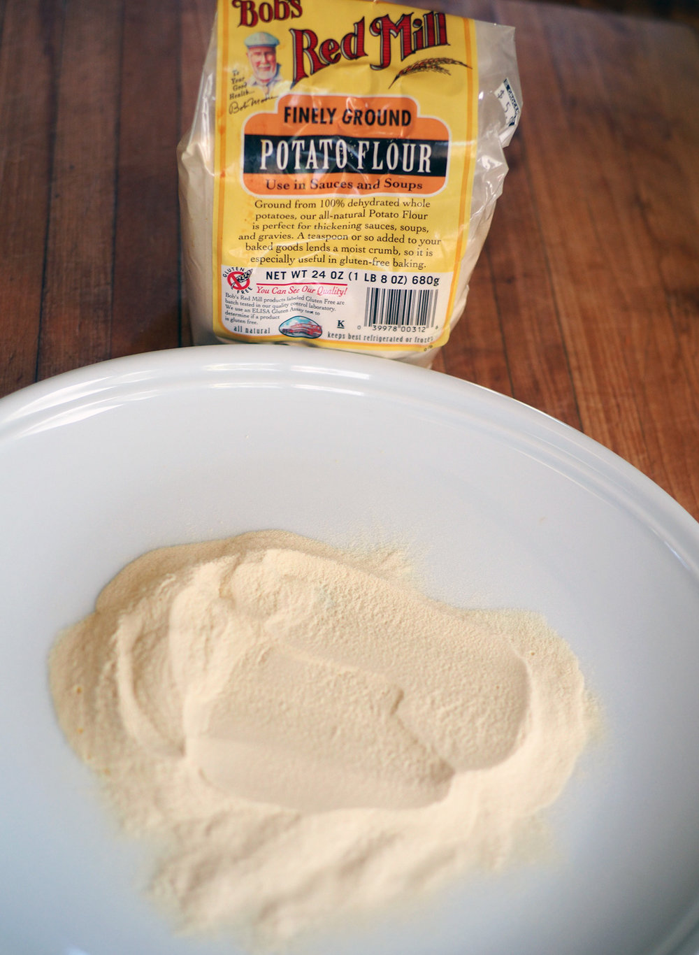 Potato flour is much finer, almost like talcum powder.