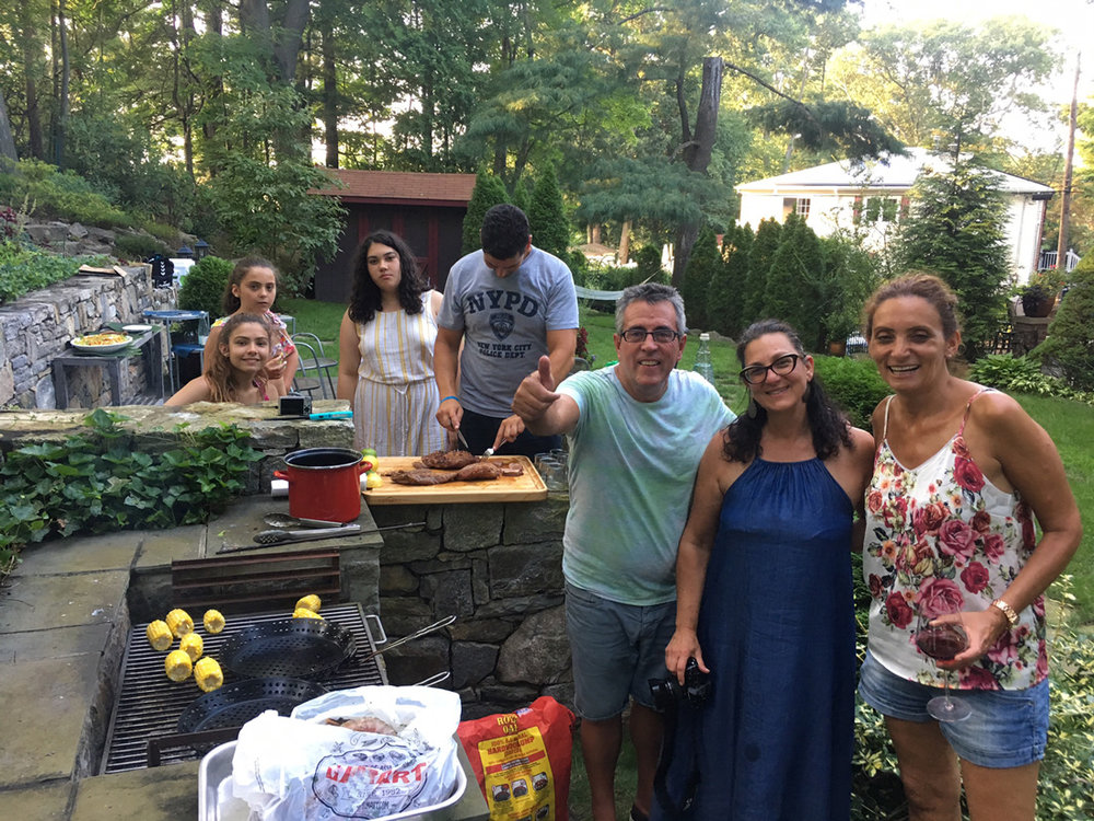 Gathering around the grill with our friends from Bilboa, Spain: Ana, JuanFran, their daughters, and Cecila   Photo credit: Angelica Intriago