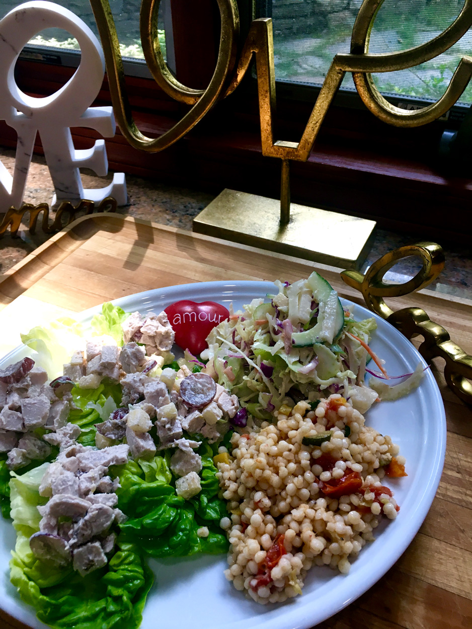 My plate full of love that I made for JC's lunch.  Boston lettuce pockets filled with zingy chicken salad, couscous and peanut slaw.