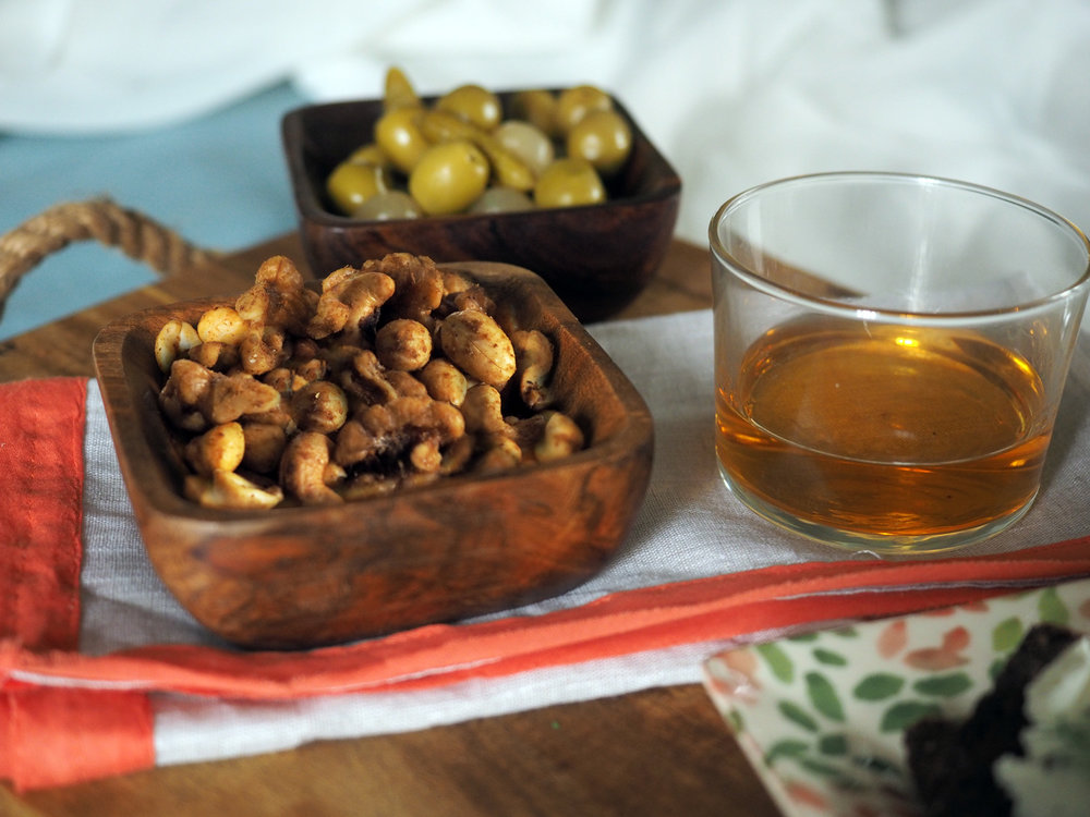 What goes better with a drink then a handful of nuts?