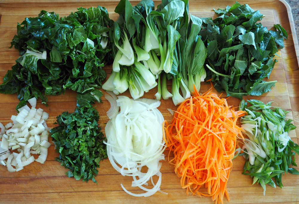 Now that is a beautiful board full of chopped up veggies.