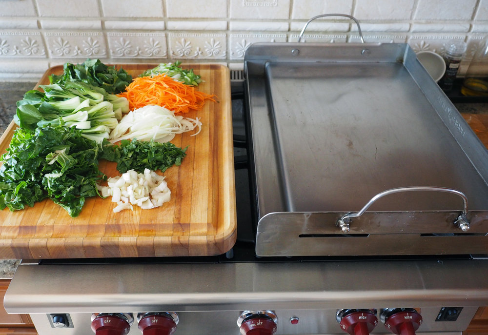 It fits perfectly over two burners. I love this plancha.